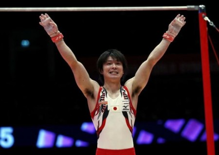 Japan's Kohei Uchimura reacts after his horizontal bar routine during the men's apparatus final at the World Gymnastics Championships at the Hydro arena in Glasgow